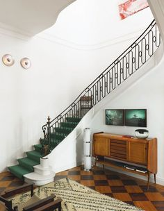 Elegant stairs accented with deep emerald green.
