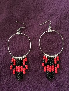 Red and black beaded drop earrings by JauntyJewelryByJill on Etsy