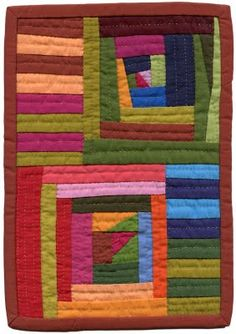 """Tuesday and Sunday"" 2011 by Nyima Lhamo, aka Andrea Balosky.   The quilt includes multicolor strips and two of her ""Log Jammin'"" blocks, which represent a loose, contemporary version of the traditional Log Cabin block. The quilt is very small and measures 7 & 3/4"" x 11"" - roughly the size of a piece of letter paper. It is all solids with a lively combination of colors, and is all hand quilted with tiny, even stitches."