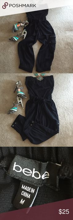 Strapless Bebe jumpsuit Drawstring waist, cargo pocket. 73% polyester 27% rayon. bebe Pants Jumpsuits & Rompers
