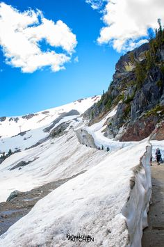 Hiking the snow walls in Whistler, British Columbia. Part of the top 10 things to do in Whistler during the summer. BC is a beautiful place to travel.