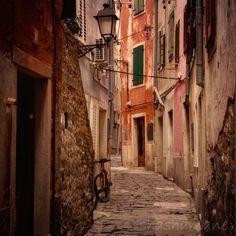 Bicycle alley, Slovenia, Italian style alleys 5x5 art photo print. $8.99, via Etsy.