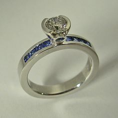 14 Karat White Gold Engagement Ring with Diamond and Sapphire