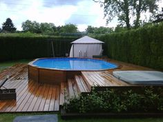 awesome above ground pools with decks. Building a deck around your aboveground pool changes the look and feel immensely. Backyard Pool Landscaping, Backyard Pool Designs, Small Backyard Pools, Above Ground Pool Decks, Above Ground Swimming Pools, In Ground Pools, Swimming Pool Ladders, Cheap Pool, Jacuzzi Outdoor