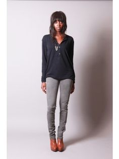 grey skinny jeans, navy top, and brown boots only taller...
