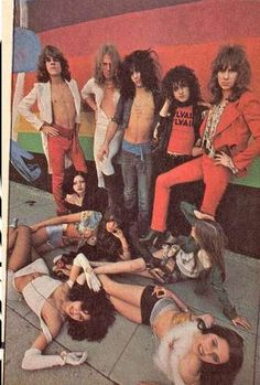 Lori, laying on the ground, with the New York Dolls in Creem magazine, August 1974.