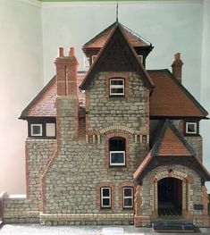 Kennet House( Dolls house) built by architect John McColgan 1989 with authentic materials. This is an exact 1:12 copy of an existing 1870's house in Ludlow, Shropshire, using the original house plans.The house is built with local stone, each stone was cut and dressed by hand.The bricks and roof tiles were pressed into purpose-made moulds, dried then kiln fired. | eBay!