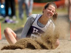 Huron Heights long jumper Julia Frey lands on her second jump at WCSSA track and field meet at Resurrection on Wednesday.