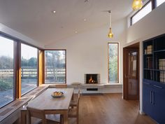 The family room with window seat and floating fire place www. Diy Furniture Decor, Walnut Coffee Table, Hearth, Great Rooms, Interior And Exterior, Family Room, Dining Room, House Design, Contemporary