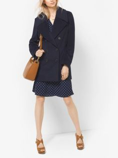 Wool and cashmere craftsmanship creates the framework of this naval-inspired peacoat. Designed with oversized notched lapels and a double-breasted silhouette, it's the ideal layer for office to after hours.