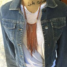Long Leather Fringe Bib <~ Brave Soul Collection ~>  This elegant leather statement piece is made with a handmade brass arched bar adorned with soft deerskin leather fringe with randomly placed African brass beads. Hammered brass diamond links attaches it to the braided leather and chain neck piece. This fun statement necklace can be worn short or long with the slide of a bead and is available in four colors.  • Pendant 2 wide by 8 long and adjustable from 14 to 26 with sliding bead. • ...