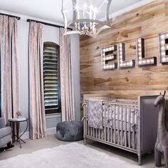 THIS NURSERY! Baby will love this charmingly rustic nursery for years to come. Instead of wallpaper, the wall behind the crib was paneled in pine planks, creating a beautifully textured accent element. Baby Bedroom, Nursery Room, Kids Bedroom, Chic Nursery, Wood Wall Nursery, Baby Girl Nursery Wallpaper, Nursery Decor, Room Decor, Themed Nursery