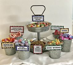 Add some fun to your graduation table by using these candy signs to display on your dessert table. This is listing is for one of each sign: Class Rings (size: 5 1/4 X 1 3/4) Congratulations Smartie Pants You Did It! (size: 5 1/2 X 2 3/4) Nerds (size: 2 3/4 X 1 3/4) Counting Beans (size: 2 1/4 x 4 1/4) Reach for the Stars (size: 2 1/4 x 4 1/4) One Smart Cookie (size: 3 1/4 x 3 1/4) Bookworms (size: 1 3/4 x 5 1/4) So l...