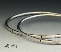 Silver Bangle, Stacking Bangle, Sterling Silver Bangle, Statement Bangle,  Bangle, Sterling Silver, Artisan Made, Metalsmith Jewelry by LjBjewelry on Etsy https://www.etsy.com/listing/453412132/silver-bangle-stacking-bangle-sterling