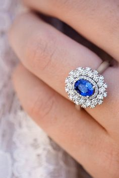 If lavish sparkle is what you're looking for, this modern halo engagement ring in 14k white gold may be your dream ring. With 98 round diamonds hand-matched for sparkle and brilliance surrounding a stunning oval 1.20-carat traditional blue sapphire, this gorgeous ring is sure to turn heads.