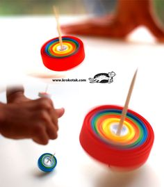 Spinning top made out of a toothpick and tightly wrapped paper.  Wind up and watch it whirl!