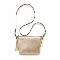 Rose Gold Fossil Crossbody Sydney crossbody from Fossil. Rose gold color, very spacious. Detachable crossbody strap, zip closure. Two interior pockets (one zip), and 6 card slots. I love this purse but I have so many that it never gets the love it needs. I've only worn it a couple times, it's practically brand new. It's in perfect condition, no stains or marks or anything! Fossil Bags Crossbody Bags