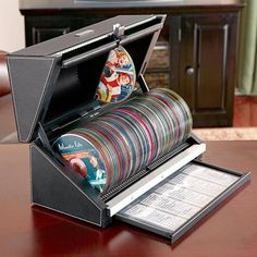 Cool idea! Wish it stored more discs, though 100 is a great start! Sure would take up a lot less space than all the storage racks! But then there's the question of what to do with the fun, colorful, and informative liner notes and DVD/CD cover art....  CD/DVD Storage
