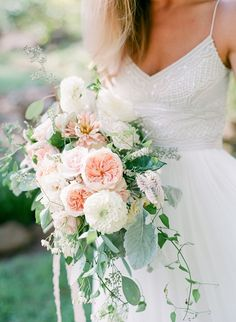 Dahlia, garden rose and rose wedding bouquet: Photography : Rach Loves Troy | Floral Design : ModFete | Wedding Dress : BHLDN Read More on SMP: http://www.stylemepretty.com/south-carolina-weddings/greenville-south-carolina/2017/03/10/this-is-how-a-wedding-stylist-says-i-do-at-home/