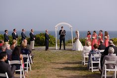 """A moment from the day that the bride can't stop thinking about? """"Looking at my husband to be along the coast of Maine as he said his vows to me,"""" Abbey said.  Ceremony Venue: Two Lights State Park  Officiant: Reverand Paul Ruckert"""