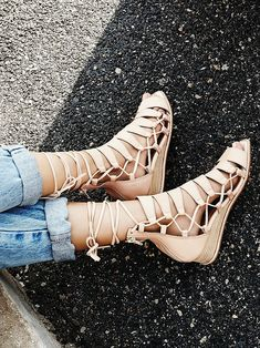 Amara Lace Sandal | Leather lace-up sandals with a square toe and cutout detailing.  Slight stacked wedge and rubber sole.  Soft and padded footbed. Exposed back zip for and easy on/off.