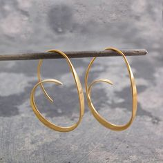 Tapered Gold Hoop Earrings - A unique take on the traditional hoop, these Tapered Gold Hoop Earrings will definitely get noticed. Gradually tapered, these hoops look wonderful and are easy to wear, too! #Otisjaxon #Jewellery