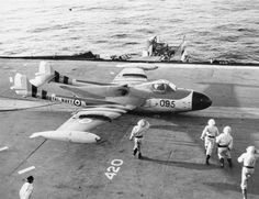 A battle-damaged de Havilland Sea Venom lands on HMS Eagle during the 1956 Suez Crisis. The British-designed Sea Venom served with the Royal Navy Fleet Air Arm and with the Royal Australian Navy. The French Navy operated the Aquilon, a version of the Sea Navy Aircraft, Aircraft Photos, Ww2 Aircraft, Aircraft Carrier, Military Jets, Military Aircraft, De Havilland Vampire, Royal Australian Navy, Royal Air Force