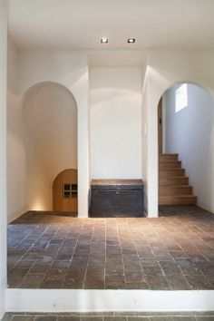 Belgian Magazine Home Sweet Home, stone floors, arch, traditional entryway