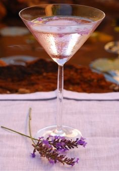 Lavendar Lemon Drop                                        2 oz. lemon vodka   1 oz. fresh lemon juice  2 lavender sprigs  1 Tbsp simple syrup