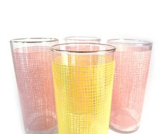 Pink and yellow drinking glasses by Federal  by reconstitutions, $26.50