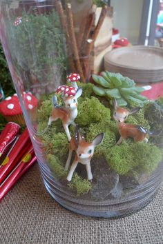 So much fun! Woodland themed party table decor idea, use a tall candle vase or a bell jar