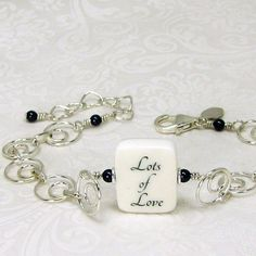 A photo charm bracelet with a message that means so much.