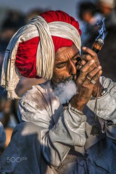 Smoking my worries away - A camel seller relaxing witha smoke after a tough day. - Smoking my worries away – A camel seller relaxing witha smoke after a tough day at work, Pushkar - Religions Du Monde, Cultures Du Monde, World Cultures, Indian Photography, Street Photography, Portrait Photography, Levitation Photography, Rajasthani Painting, Indian Paintings