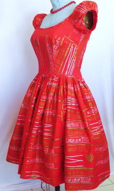 This beautiful Honolulu red Shaheen Surf n Sand vintage dress is from the 1950s era. I have not seen another one like this. A polynesian hand screened red cotton with a silver and golden or bronze asian print.