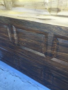 Custom painted aluminum garage doors painted to look like stained wood by Holly Blanton Art 904-294-5511