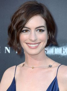 The Curling Iron Trick You Have to Know to Re-Create Anne Hathaway's Waves