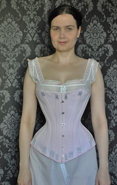 Lovely hip spring. Single layer Victorian style corset from coutil with external bone casings and flossing.  Somewhat based from the 1880s corset in Norah Waugh's Corsets and Crinolines. via The_Aristocat on LiveJournal.