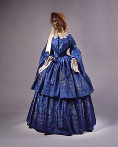 Not wild about the lace collar *and* fringe, but love, love, LOVE the gorgeous blue silk fabric!!! Wow!