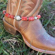Dress up your boot with a handmade beaded boot bracelet including red, rectangle shaped stones and small silver flowers! -Incorporated with a silver bead! -15 Inches - Alligator Clasp