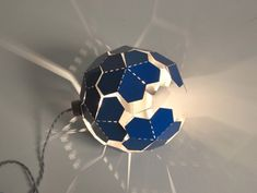 Comete Lamp by Elaine Fortin and Virginia Lamothe - The laser cut and perforated steel Comet is sold flat and it's up to the user to fold it into the desired shape. It can be folded into a sphere or more randomly into an organic, abstract shape. | #Lamps #Lighting #Design #InteriorDesign |