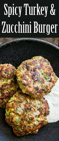 spicy turkey and zucchini burger turkey burger patties with grated zucchini herbs cumin and cayenne served with lemony sour cream sauce