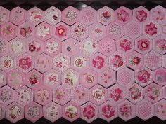 hexagon quilt, but with grey, black and a more pale pink.