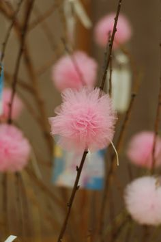 tulle pom-poms on branches - great centerpiece!