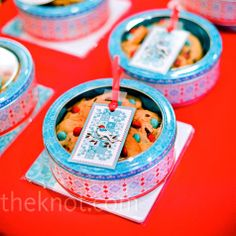M&M; Cookie Favors    M&M;'s cookies (with aqua and red candy, of course) were packaged up into cute tins and given to guests.