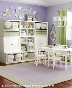 This wall unit is simple but elegant. Would be great for toy/craft storage, and would grow well with the girls (especially if we build it to separate). Also, I love the purple paint and the butterflies and flowers above; it's a nice whimsical touch.