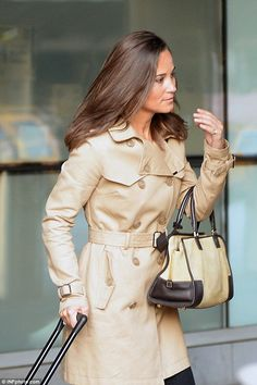 Miss Middleton, 31, showed off a perfect blow-dry, pristine Macintosh and coordinated hand...