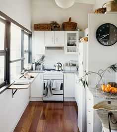 A shot of Sam's kitchen. With white cupboards and lots of utensils.