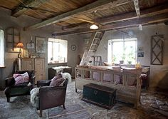 Rustic country home - beautiful timber beams, stone floors, leather armchairs & fur throw. Lönngren/Widell Photography.
