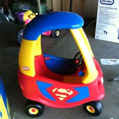 Spray paints superman car. Done by me and friend for my nephews first birthday. The hood, hub caps, both doors and the gas tank are all spray painted