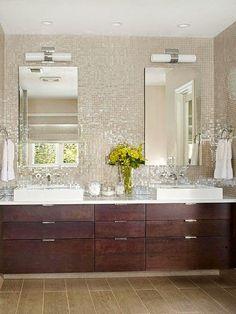 iridescent small square tiles, white countertops, dark wood cabinets